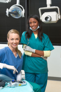 Pediatric Dental Assistants smiling for camera