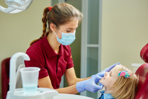 PDAS dental assistant with child