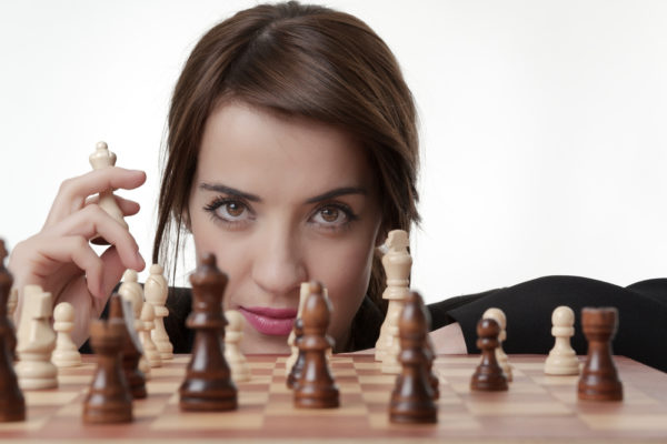woman making chess move